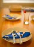 Place settings on laid table Stock Photography