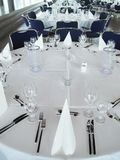 Place settings on round banquet table Royalty Free Stock Images