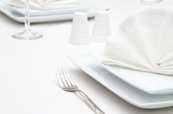 Place settings with white plates Stock Photos