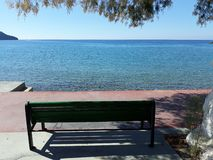 A place in the shade. Bench sea tree shade sun stock image