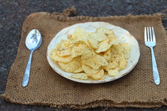 Place the Snacks on a white dish served with potatoes. Stock Photo