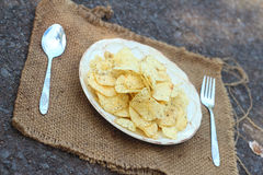Place the Snacks on a white dish served with potatoes. Stock Image