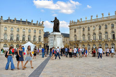 Place Stanislas in center of Nancy. Tourists arrive to restored Place Stanislas in historical center of Nancy on July 6, 2013 in Nancy. This square is in World Stock Image
