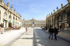 Place Stanislas (Nancy - France). View of the famous Place Stanislas of Nancy (France), with the monument of Stanislas and the Hotel de Ville on the background Stock Photos