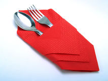 Place on the table. A nice place with a silvery spoon and fork, covered by a nice red napkin Royalty Free Stock Photo