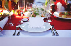 Place at the table. Beautifully decorated place at the table with the guest card Stock Photos
