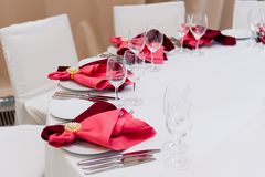 A place at the table served with a red napkin