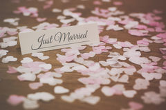 Place tag surrounded by heart shaped confetti Stock Photos