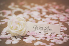 Place tag surrounded by heart shaped confetti Royalty Free Stock Images