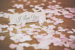 Place tag surrounded by heart shaped confetti Royalty Free Stock Photography