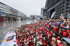 Place of terrorist act in Berlin on December 19, 2016. BERLIN, GERMANY - Jan 30, 2017: Candles and flowers in tribute to victims of December 19, 2016 terrorist Stock Photos