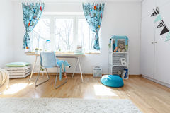 Place to do your homework. Shot of a spacious cosy children's room Stock Photos
