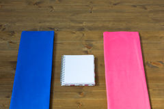 A place to record the results of men and women. Pink and blue towel on the floor Stock Photography