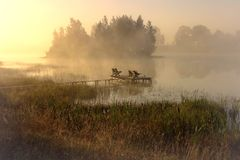 A place to rest . Foggy morning. Beautiful place to rest by the lake /  foggy summer morning / amazing light,view,colors,mood / Lithuania,near Siauliai / smal Stock Image