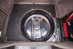 Place under the spare tire in the trunk of the car.  Stock Photography