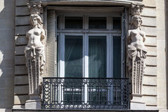 Place Vendome Paris. Two female sculptures adornments on a window of a historical building in Place Vendome, Paris, France Royalty Free Stock Photo