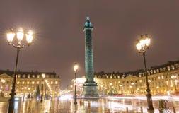 The place Vendome at rainy night, Paris, France. The place Vendome decorated for Christmas at rainy night, Paris, France Royalty Free Stock Images