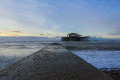 Sunset on Brighton West Pier. Brighton burned West Pier, UK Royalty Free Stock Photo