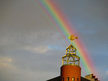 Place weather wane in Hamurg Fish market against rainbow. Weathercock in the shape of a fish on an apartment house on St. Pauli Fischmarkt in Hamburg, Germany stock images