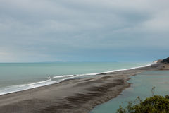 The place where a river meets  the ocean Stock Photos