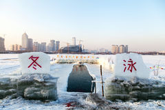 PLACE FOR WINTER SWIMMING. A place specially equipped for winter swimming in China.The meaning of the word is swimming Royalty Free Stock Photos