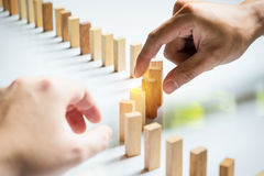 Place a wooden block lines Business team solving a problem Stock Images