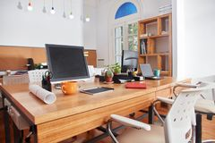 Place of work at coworking office. Place of work at coworking business office company Stock Photos