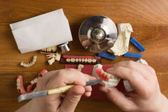 Place of work of the dental technician with hands Royalty Free Stock Images