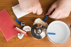 Place of work of the dental technician with hands Royalty Free Stock Photo