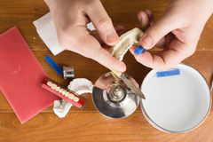 Place of work of the dental technician with hands Royalty Free Stock Photos