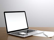 Place of work. With laptop and smart phone on desk next to the wall Royalty Free Stock Photography