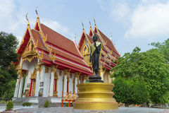 Place of worship with black standing buddha statue Stock Image