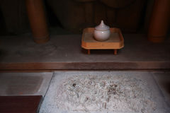 Place of worship. Deities with fossilized plate with traces of sacrificial utensils and in the Shinto temple Stock Photography