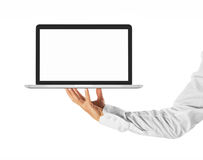 Place for your advertisement -Hand holding a laptop Royalty Free Stock Photo