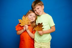 Place for your text. Happy baby. Autumn leaves background. Leaf fall happy people and joyHello november. Autumn Clothing. And color trends. Leaf fall leaves stock photography