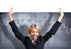 Place your text. Young businesswoman lifting white blank banner above head Stock Images