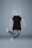 Placed clothes in action with woman drawing Royalty Free Stock Images