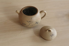 Placed on the table of handmade ceramic teapot, lid,. This tea culture places emphasis on the taste and color of the tea as well as on the presentation of the Stock Image