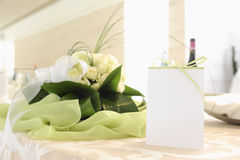 Placeholder with green ribbon on a table with a bouquet of white Royalty Free Stock Images