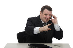 Placeman sits at office desk and talking on phone Stock Image