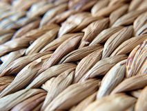 Placemat. Braided brown dining mat.Close up background Stock Photo