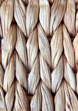 Placemat. Braided brown dining mat.Close up background Stock Photos