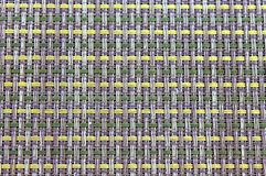 Placemat. With yellow and green woven parts Royalty Free Stock Photography