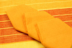 Placemat and napkins. Decorative elements napkins and placemats of various colors stock photo