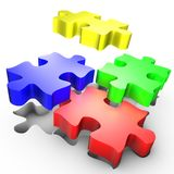 The placement of colored pieces of puzzle. Symbolises the action of setup a process Stock Photos