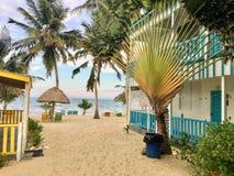 Placencia, Belize - May 26th, 2018: Piękna piaskowata plaża z a fotografia royalty free