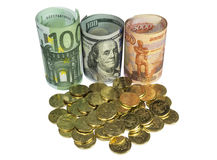 Placer coins on background of banknotes. Stock Photos
