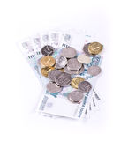 Placer coins on banknotes Stock Photo