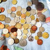Placer of coins of different countries Stock Photo