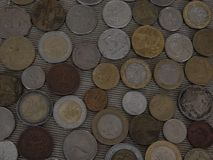 Placer of coins of different countries money Royalty Free Stock Images